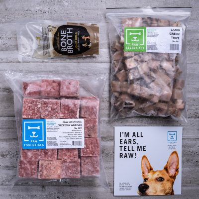 Assortment Of Raw Essential Products For Puppies Including, Bone Broth, 1KG Plastic Pack Of Small Cubed Lamb And Green Tripe Meat Mix, 3KG Plastic Pack Of Cubed Chicken And Wild Meat Mix, Raw Essentials Advice And Nutrition Pamphlet