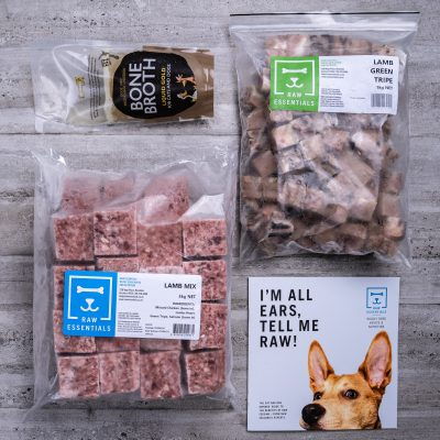 Assortment Of Raw Essential Products For Dogs Including, Bone Broth, 1KG Plastic Pack Of Small Cubed Lamb And Green Tripe Meat Mix, 3KG Plastic Pack Of Cubed Lamb Meat Mix, Raw Essentials Advice And Nutrition Pamphlet